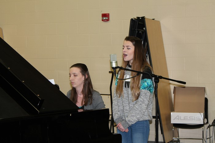 Student Jacqulynne Ronkowski singing with Music Teacher Laura Gorski accompanying on piano for Empty Bowls 2017