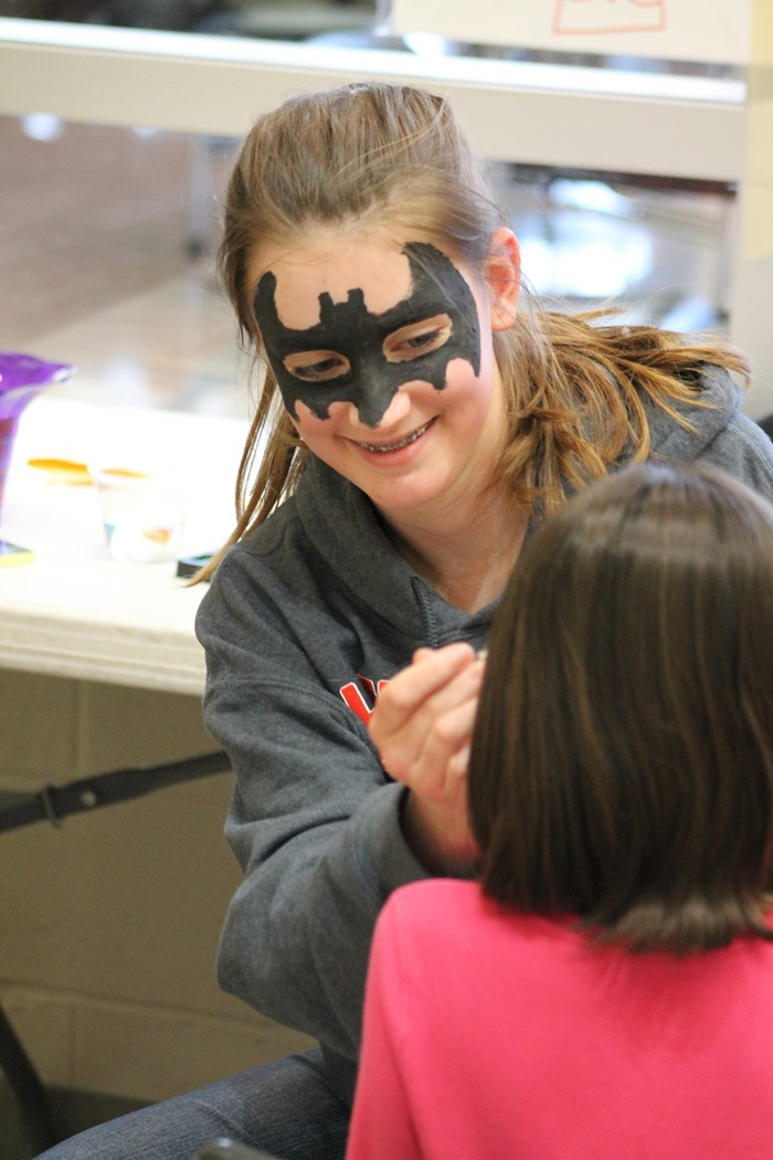 Student face painting at Empty Bowls 2017